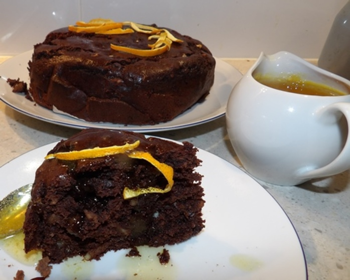 plated,orange,chocolate,cake,with,warm,orange,syrup