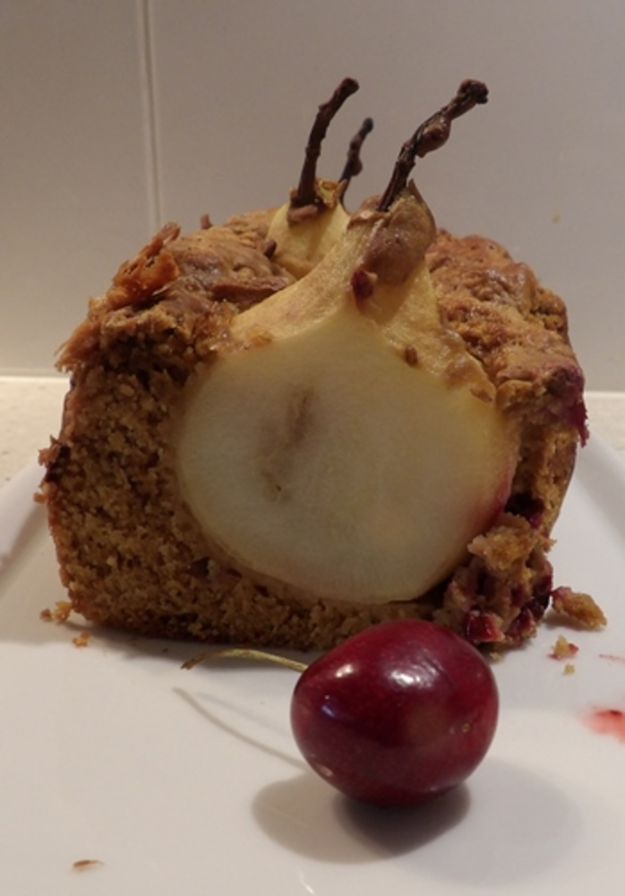 plated,pear,and,blackberry,cake