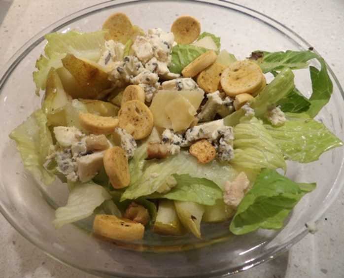 plated,pear,caesar,salad,with,croutons,and,walnuts