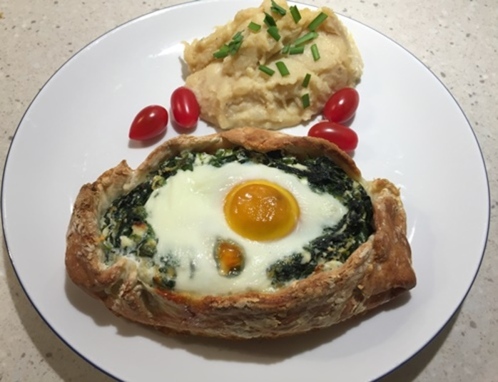 plated,spinach,and,egg,pie,with,potato,mash
