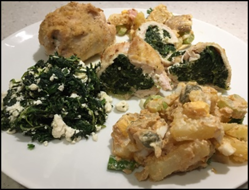plated,spinach,and,feta,chicken,with,potato,salad