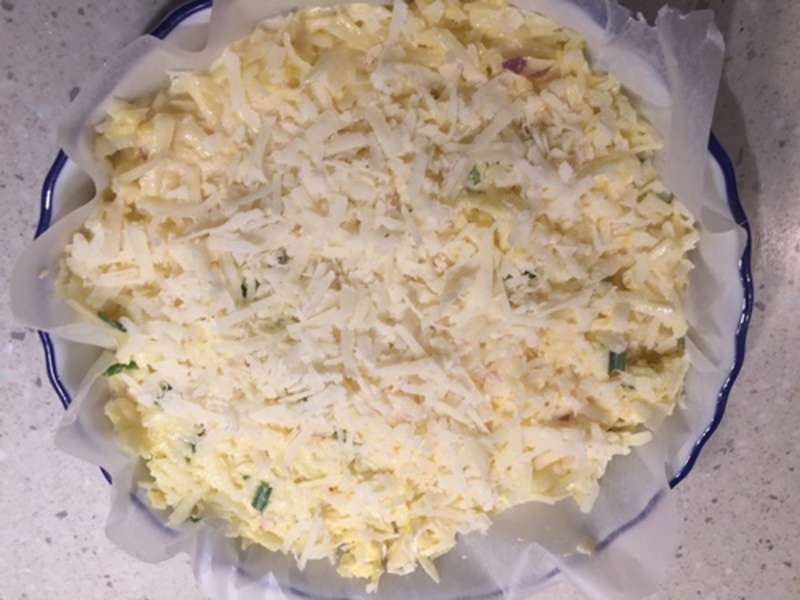 mixing,ingredients,for,potato,casserole  - Baked Grated Potato Casserole