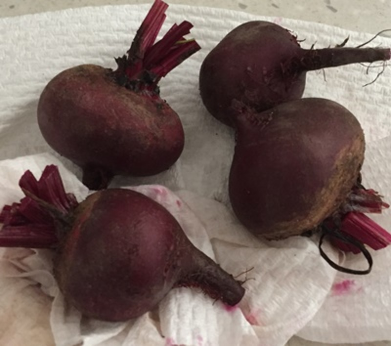 preparing,beetroot,for,roasting  - Quinoa Salad with Oranges, Beetroot and Pomegranate