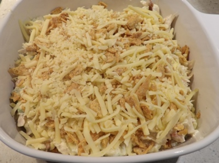 mixing,grated,cheese,and,crushed,potato,chips