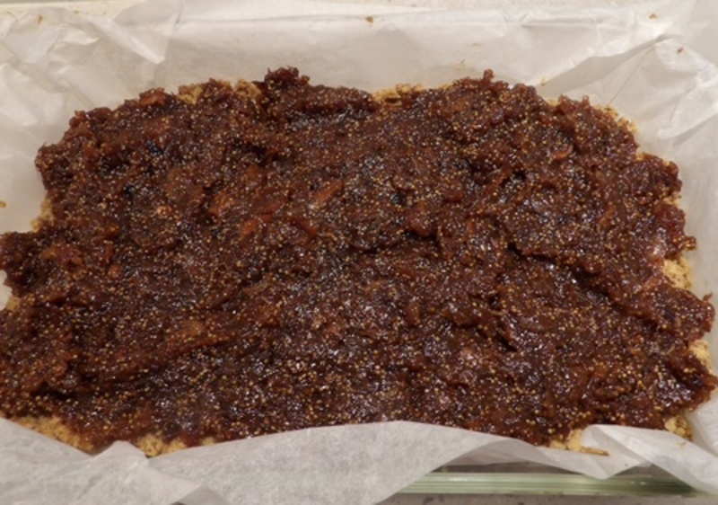 mixing,figs,with,sugar,water,and,cinnamon,stick  - Fig and Cinnamon Slice