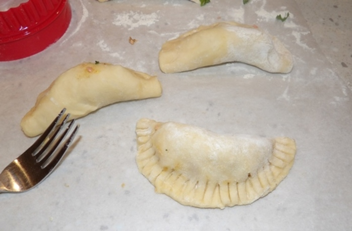 putting,filling,in,dough,and,crimping,edges