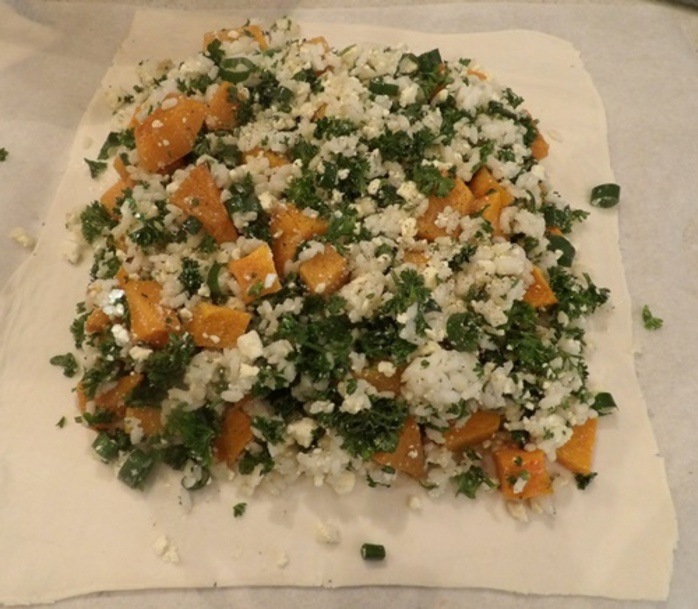 mixing,pumpkin,and,feta,plus,other,ingredients,for,pastie