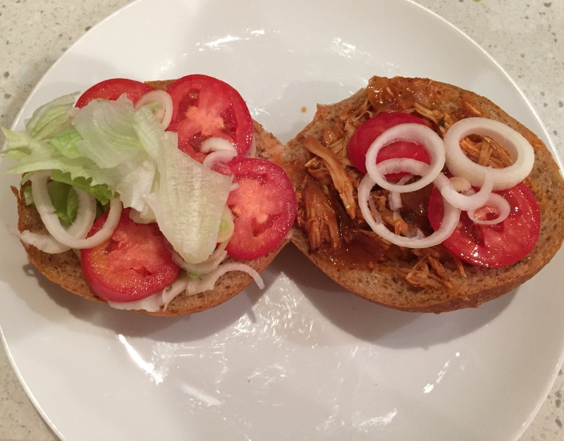 putting,salad,on,burger  - Slow Cooker Pulled Chicken and Burger