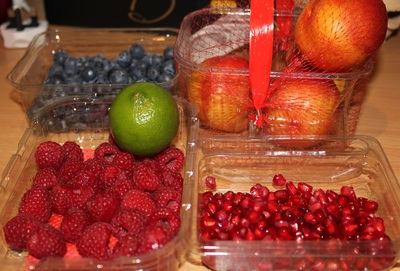 raspberries, blueberries, peaches, lime, pomegranate seeds, antioxidant