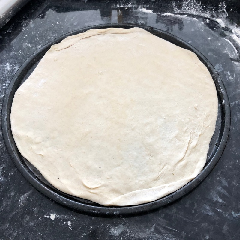 knead the dough well, for about five minutes and form into two equal round balls.  - Easy Family Pizza