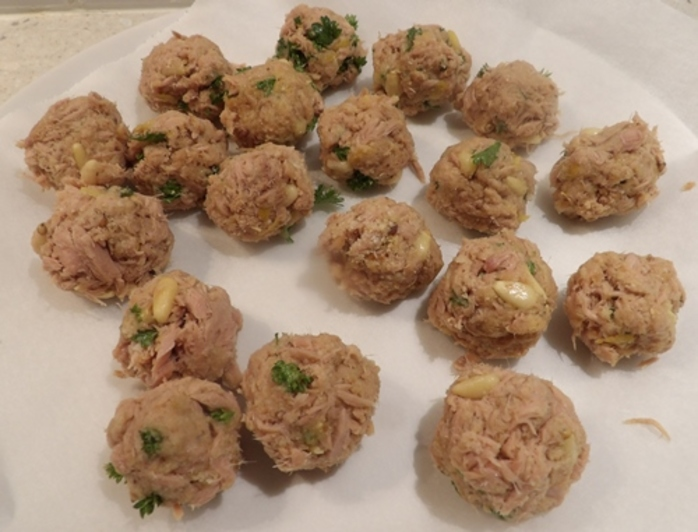 mixing,ingredients,for,tuna,balls