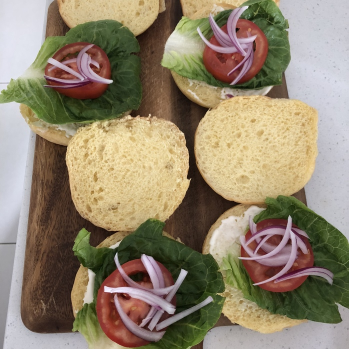 Salad added to the burger buns