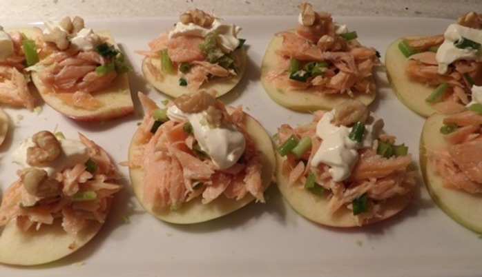 salmon,on,apple,slices,with,oil,creme,fraiche,and,chives