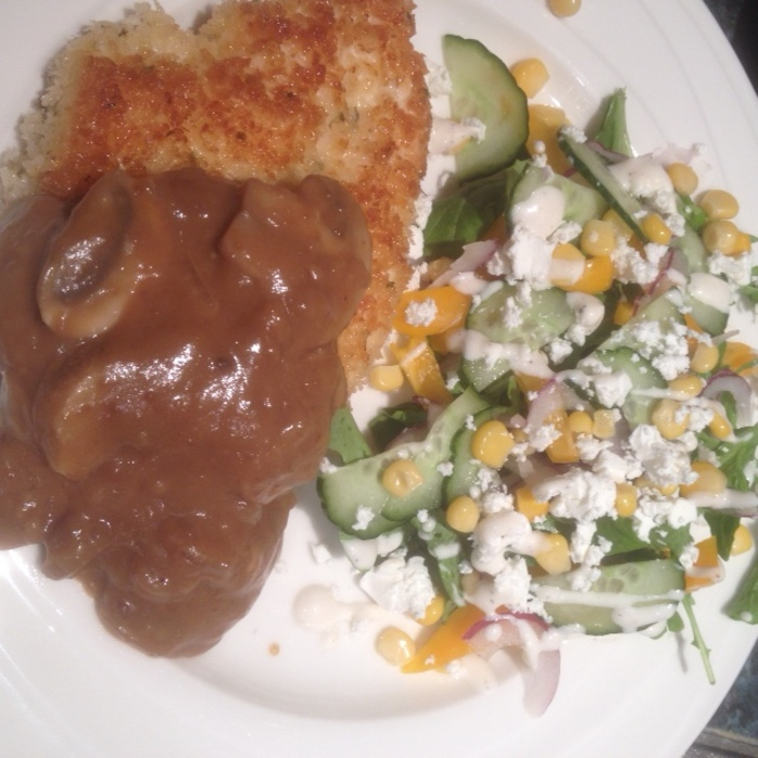 Schnitzel with mushroom sauce and salad