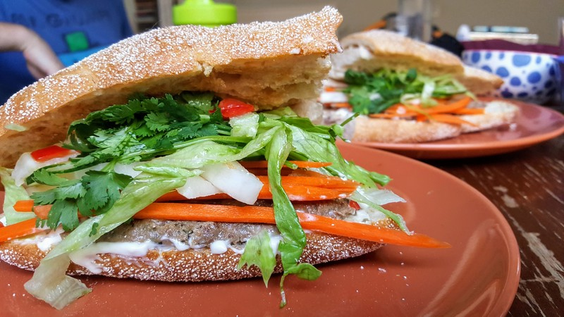 Spicy Beef Banh Mi with carrot, daikon, cucumber, lettuce, chilli, mayo and soy sauce  - Spicy Beef Banh Mi