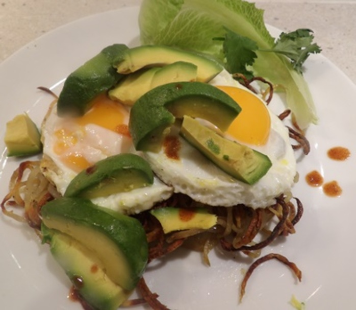 spiralised,potato,baskets,filled,with,eggs,and,avocado