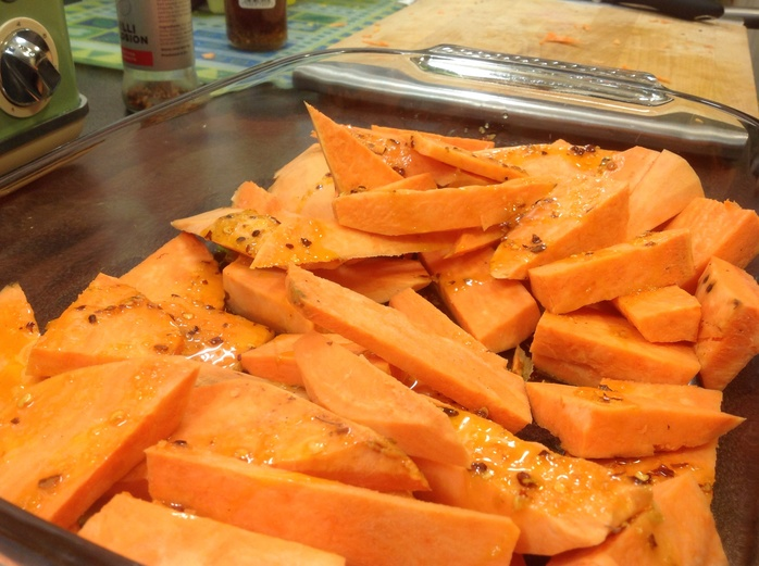 Sweet potato wedges, chopping board