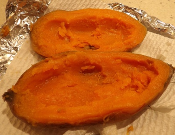 taking,out,sweet,potato,to,make,skins
