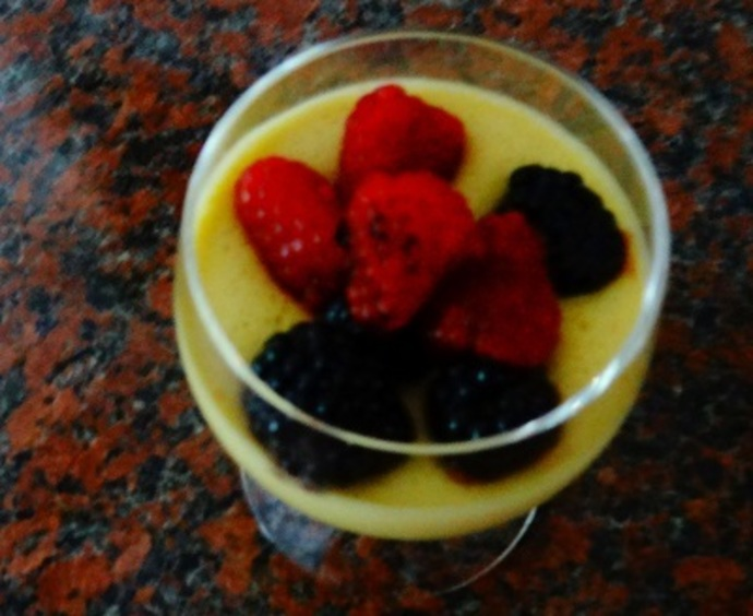 Top the chilled zabaglione with the macerated berries