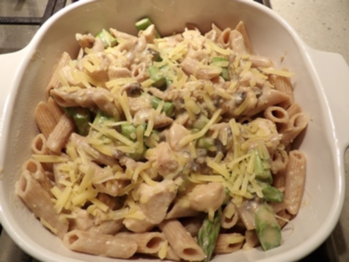 adding,all,ingredients,to,chicken,mushroom,asparagus,pasta,bake