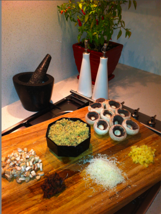 Cous Cous, Anchovies, Mushroom Stalks, Feta and Parmesan Cheese, Chilli, Pepper, Basil and Oregano make up the key ingredients of this stuffing mix up the   - Stuffed Mushrooms