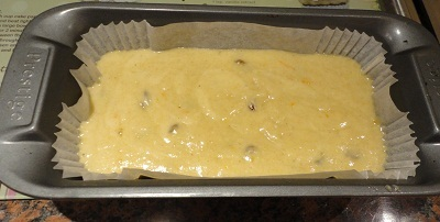 The cake mixture in the prepared tin