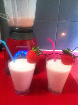 Two ready made strawberry and banana smoothies