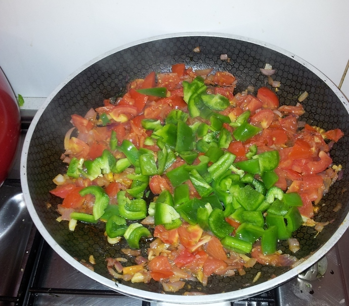 Add chopped capsicum to the onion/ garlic/ tomato/ dill base.