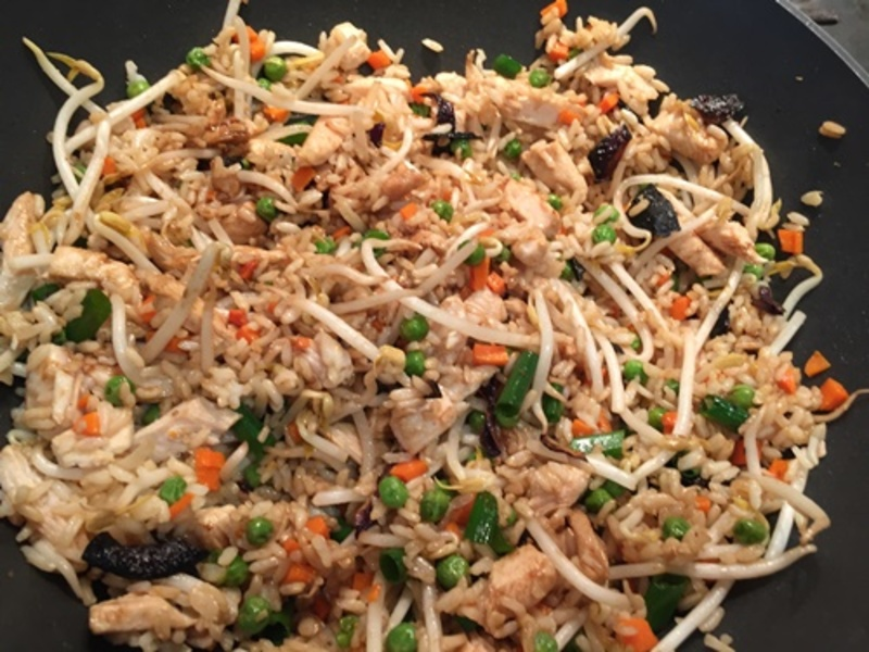 adding,cooked,chicken,to,vegetables