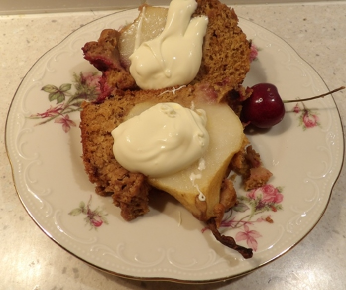 slicing,pear,and,blackberry,cake
