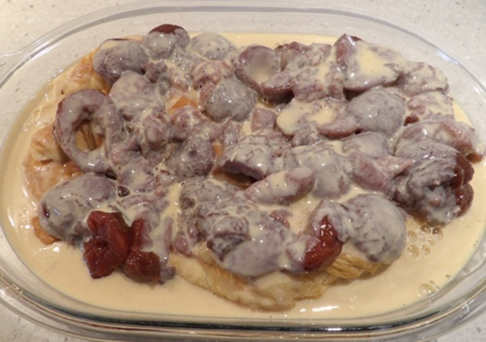 layering,croissant,pieces,and,plums,for,chocolate,croissant,pudding