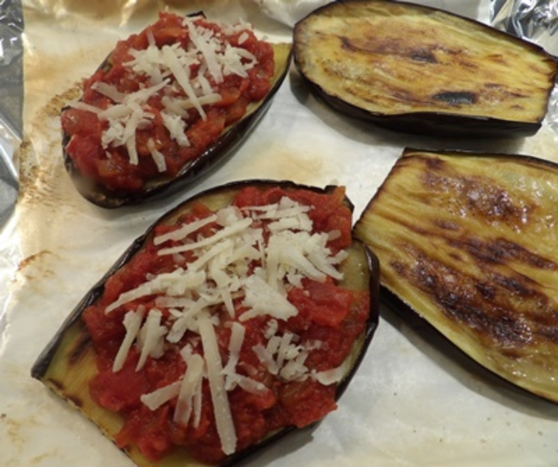 putting,oil,on,eggplant,before,grilling  - Eggplant with Mozzarella and Cooked Tomato Sauce Stacks