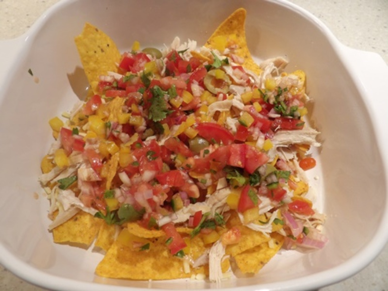adding,salsa,to,cheese,and,corn,chips