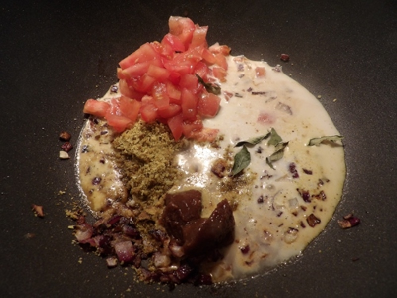 cooking,the,onion,garlic,and,ginger  - Goan Fish Curry