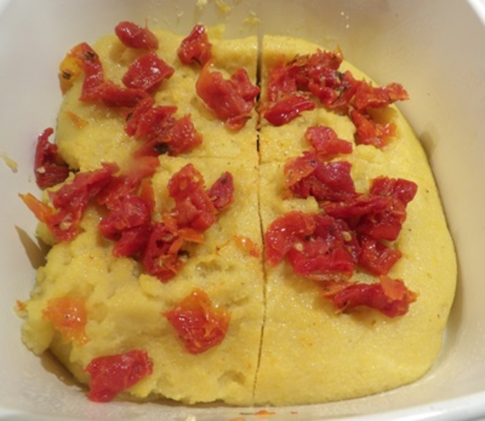 adding,butter,to,cooked,polenta