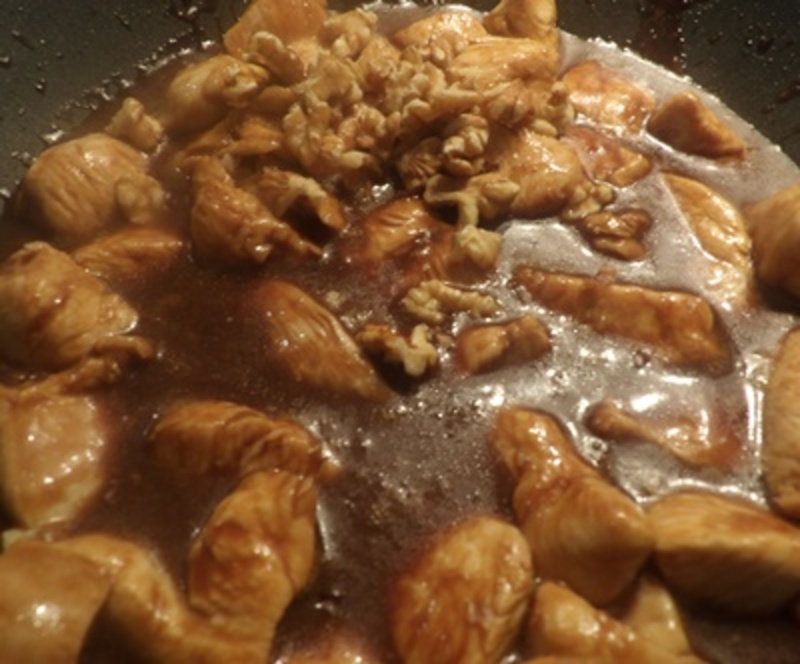 cutting,chicken,up,for,walnut,and,hoisin,chicken