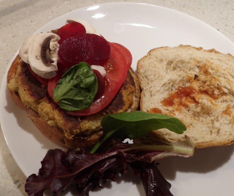 putting,pattie,on,toasted,roll  - Peanut Pattie Hamburger with Home Made Spicy Barbecue Sauce