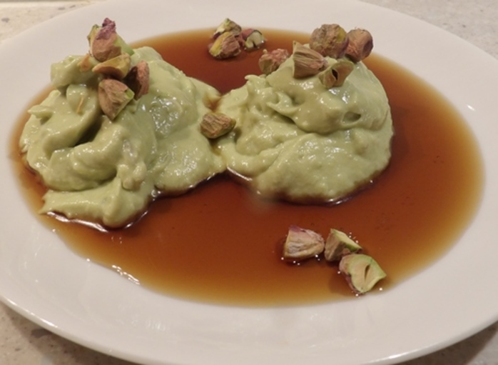 avocado,dessert,with,maple,syrup,and,pistachios