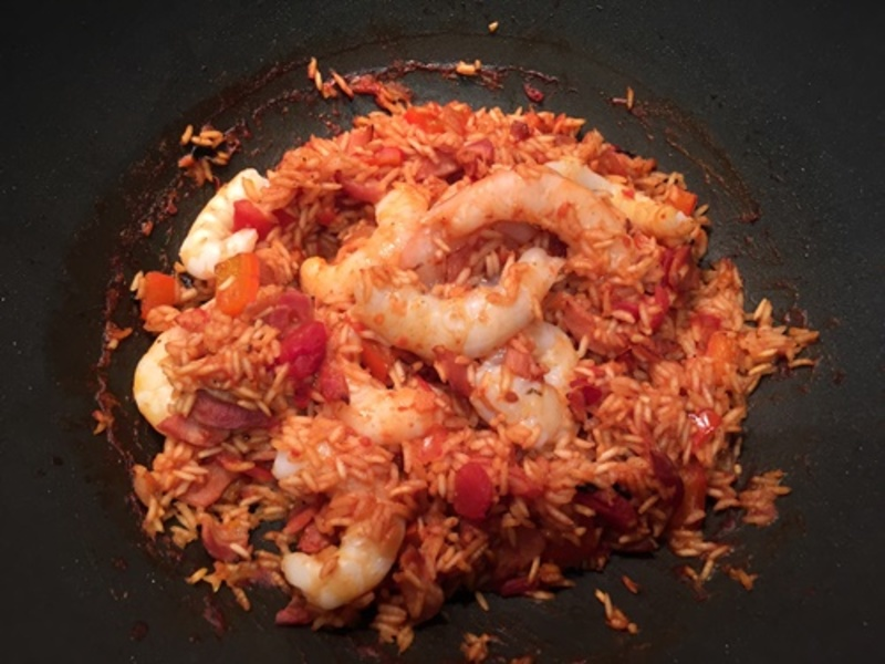mixing,in,rice  - Creole Rice with Bacon and Prawns