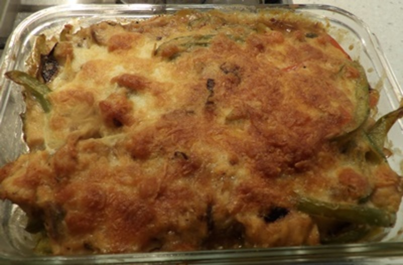 putting,lemon,rice,in,dish  - Salmon and Asparagus Casserole with Lemon Rice