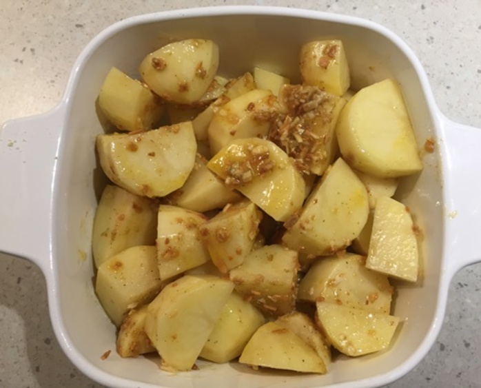 baking,potatoes,with,onion,mix