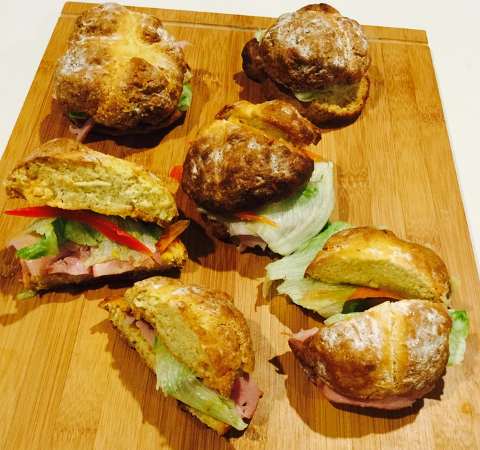 Bread rolls with ham, salad, melted cheese and mustard