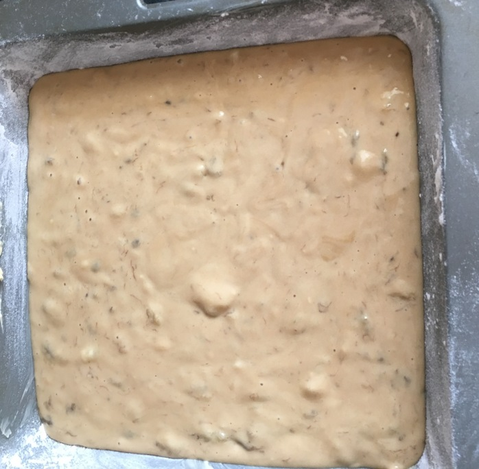 Cake batter evenly spread in the tin