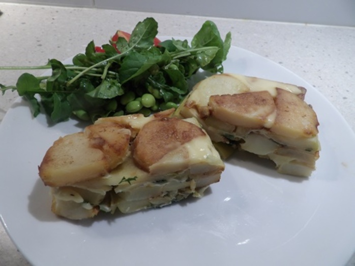 camembert,and,potato,terrine,served,with,salad