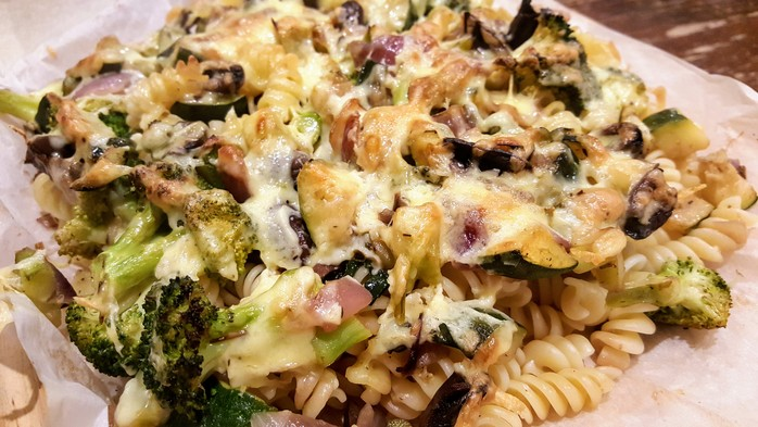 Cooked pasta and vegetables with cheese