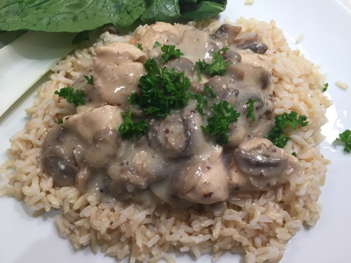 chicken,stroganoff,with,mushrooms,on,a,bed,of,rice