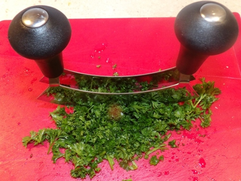 chopping,parsley,finely,for,celery,boats  - Celery Boats Party Food