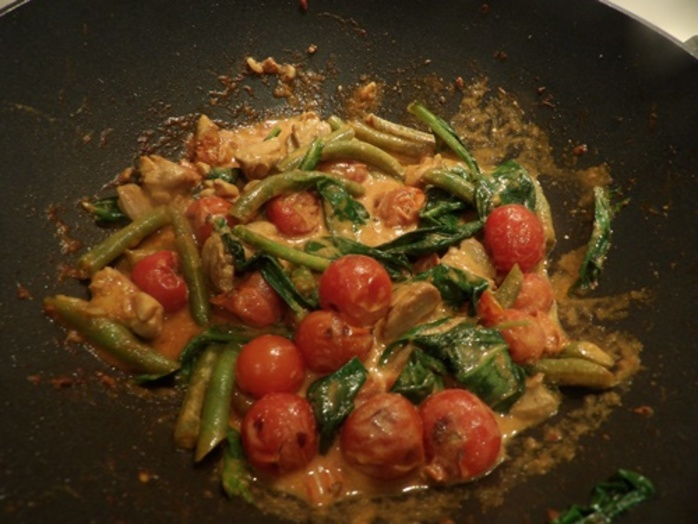 cooking,chicken,with,vegetables,and,spices