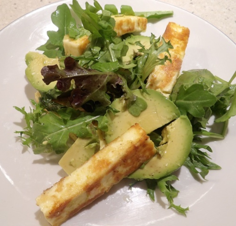 dipping,halloumi,slices,into,seasoned,flour