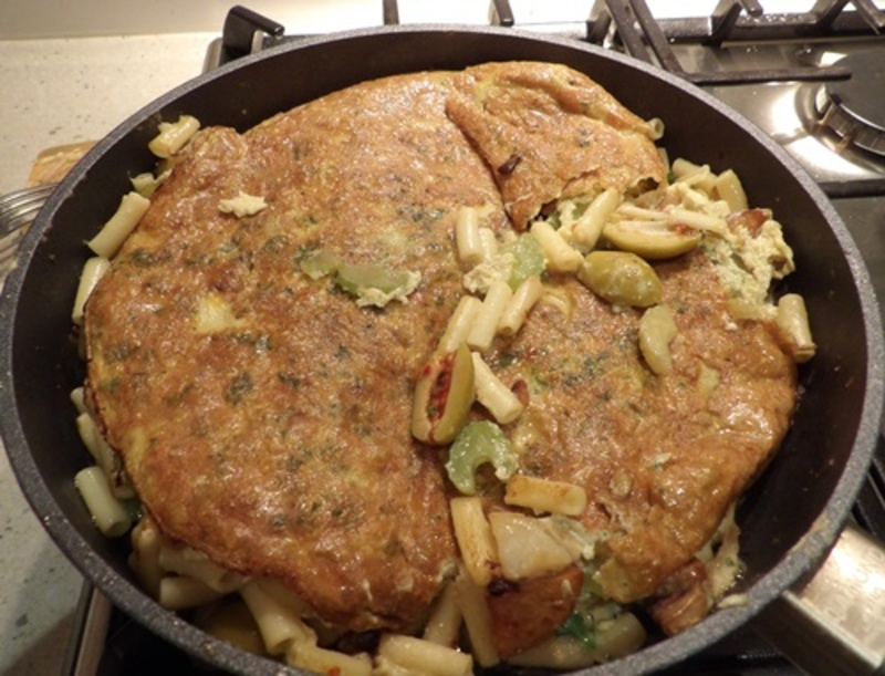 cooking,celery,onions,and,potato,for,frittata